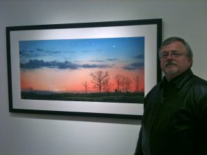 Bill with one of his watercolors, at the Blue Spiral.